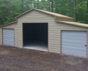 tan-metal-garage-with-a-fram-and-two-lean-tos